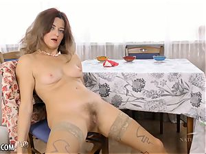 hairy Housewife wanks on kitchen table