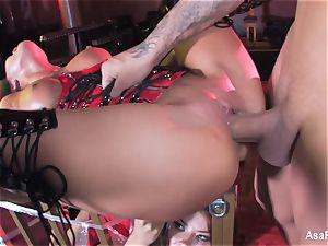 Asa Akira gets pulverized on top of a encaged Sophia Santi