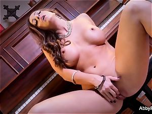 brown-haired honey Abigail Mac rubs her coochie