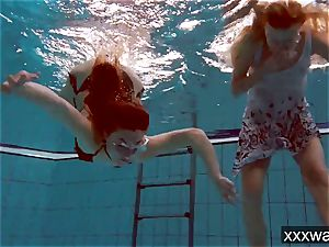 sizzling Russian women swimming in the pool
