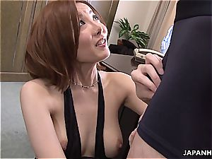 Yuna inhaling her manager in the office