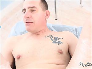 Dana mistreats her man with a massive dildo