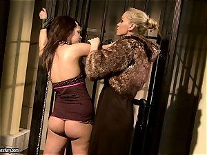 Kathia Nobili in wooly jacket torturing a hot stunner